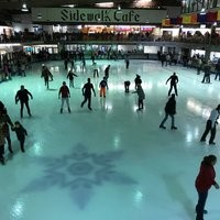 Ice skaters having fun at Ober Gatlinburg's indoor skating rink.