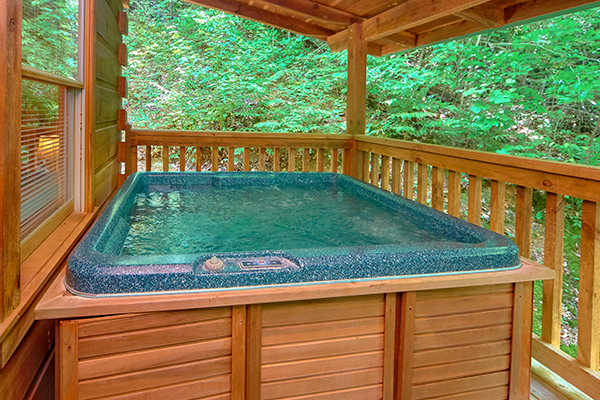 a hot tub on a covered deck at Wild Crush in Pigeon Forge, TN
