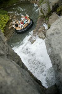 River Rampage ride at Dollywood floats past a waterfall.