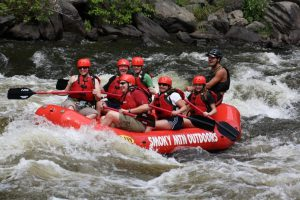 A group of people enjoying white water rafting in the Smoky Mountains.