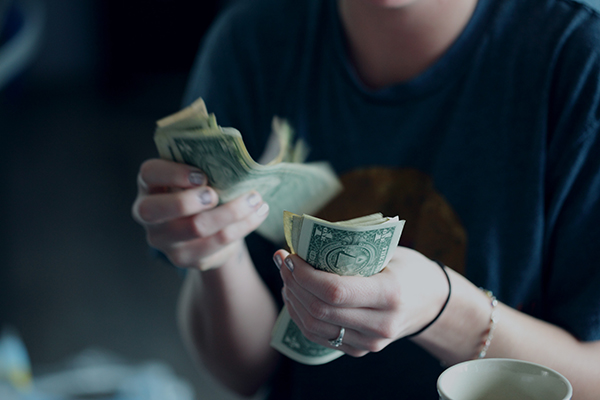 A woman counting American money