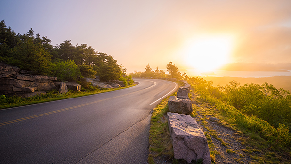 Mountain road with sunset