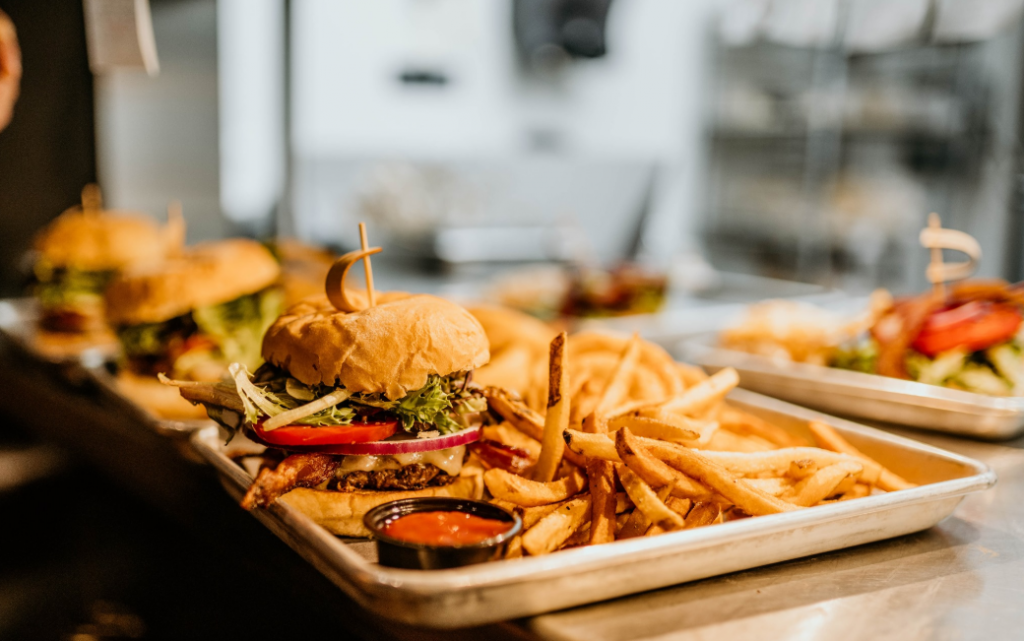 Hamburgers and french fries on trays