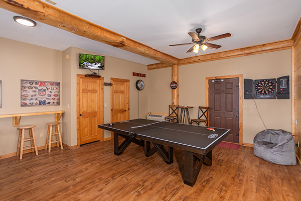 Game room featuring darts and ping pong at Great View Lodge - a Pigeon Forge cabin rental