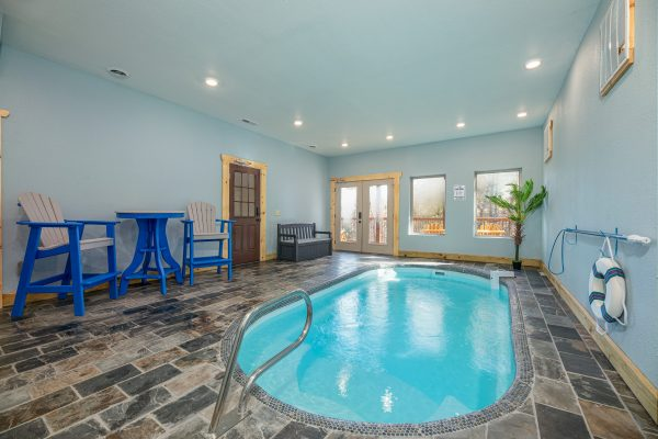 An indoor pool at a cabin in gatlinburg