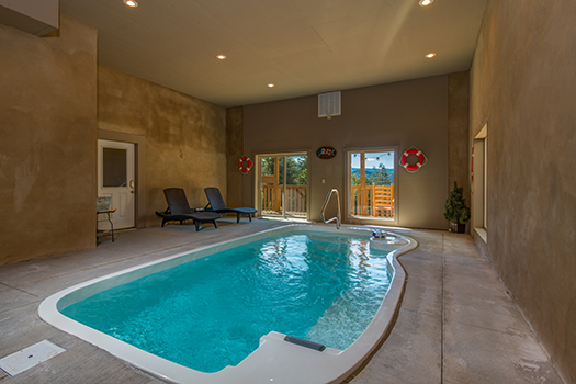 a pigeon forge cabin with an indoor pool - canyon camp falls