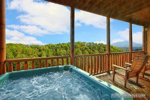 hot tub with a view at majestic mountain view, a rental cabin