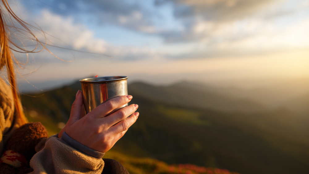 a cup of coffee in the mountains