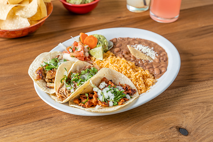 mexican food tacos served with rice and beans